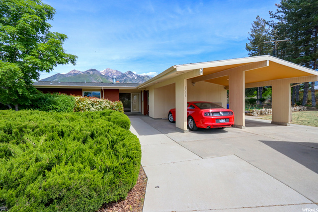 MULTIPLE OFFERS UP TO $700k RECEIVED. CAN BE SHOWN WITH 2 HR NOTICE, DEADLINE IS 5 PM 6/8.  Just east of Oakdale Elementary School hidden back on almost a cul-de-sac with 180 degree views of the Wasatch mountains! Updated and in pristine condition with custom maple cabinets/black granite counters and maple floors on the main level with large picture windows looking east. Beautiful green glass tiled fireplace, built-in shelving and cabinetry in the den, food or wine storage under the front of the home in the cold cellar, massive kitchen down with walkout- basement. Big garden, no...really big garden for urban farmers and a giant dog run which basically is the fruit orchard fenced in for pets. All appliances stay, large laundry room is usable but framed in with the sheet rock and lumber to stay. This would work great as a mother-in-law apartment situation as there are sep. entrances/ 2 kitchens...plenty of room! Sellers are relocating to a new construction home out of state and may need rentback until the end of July 2021.  Property just appraised, square footage taken from that appraisal.
