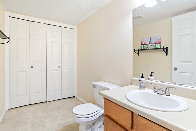 laundry/bath next to kitchen/living