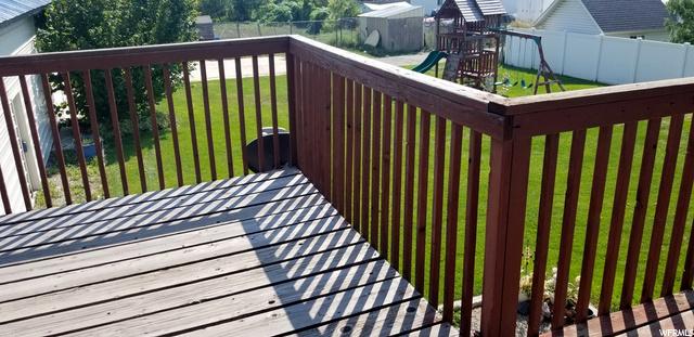 Large Deck Overlooks Landscaped Backyard