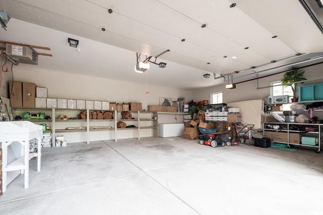 Large 3 car garage with built in shelves