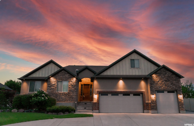 Here it is- your custom built Rambler in a quiet Lehi community ready for the next chapter in its time. This beauty has 8 (yes, 8!) bedrooms, 3.5 baths, a second kitchen, a theater room, a massive bonus room over the garage, and a lush landscaped yard with mature trees for shady summer afternoons and evenings. Enjoy time on the covered deck or walk out patio from a fully finished basement. This walkout is also set up (electrical) for your hot tub for relaxing, quiet, and private nights in a soak to melt the day away. With central vacuum, built in audio system, granite countertops, and oversized 3 car garage, this is one with features you don't want to miss. The functionality of this home is limitless with so much room and many amenities.       Measurements and descriptive for courtesy only. Buyer or buyer agent is advised to verify information if influential in a decision.