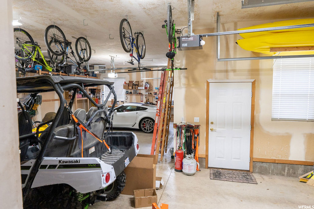 3 car garage attached ( 2 garage doors w/automatic opener, heated, central vacuum location, water drains)
