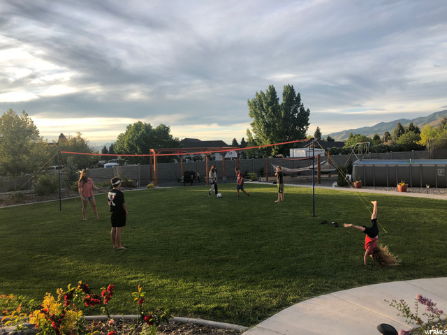 Backyard grass area perfect for entertaining & yard games