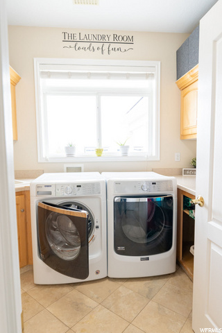 Laundry room w/water drains under washer/dryer