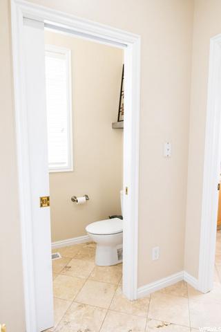 looking into 1/2 bathroom next to mud room - pocket door