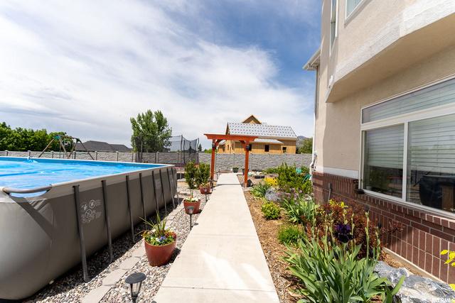 Backyard arbor to playground and garden