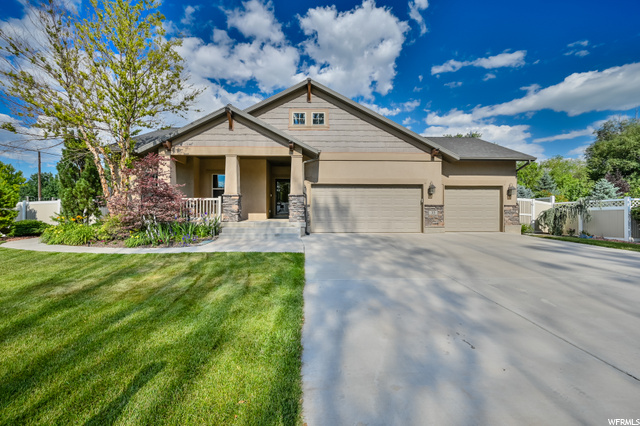 Wonderful home located in the center of Lehi City on a corner lot with great curb appeal. Open floor plan on main level with vaulted ceilings and fireplace in family room. Kitchen features Corian countertops, recessed lighting, gas range, and lots of cupboard space. Primary bedroom on main level with large primary bathroom, separate tub and shower, double sinks, walk in closet, and separate water closet. Laundry and additional bedroom on main level. Basement with two bedrooms, a full bath, a large family room, and kitchenette that has refrigerator, sink, and disposal. Unfinished room that can be turned into an additional bedroom or in home gym. No HOA. Large tuff shed can be used for storage. Heated and cooled 3 car garage with fully insulated garage doors and 3 car driveway. Fully fenced backyard with large covered patio and awning for wonderful entertainment opportunities with a well maintained garden.  Central Vac, In Wall Speakers, Intercom and other added features like newer Water softener, AC, and furnace. Check out the 3D tour and schedule a tour today!
