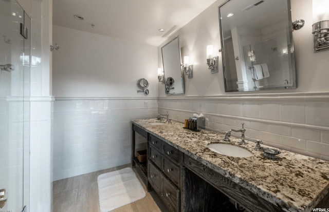 Beautifully appointed bathroom with double vanities
