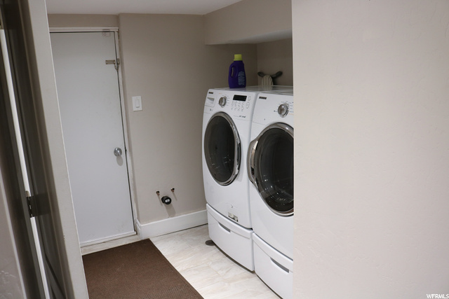 Second entrance next to included washer and dryer