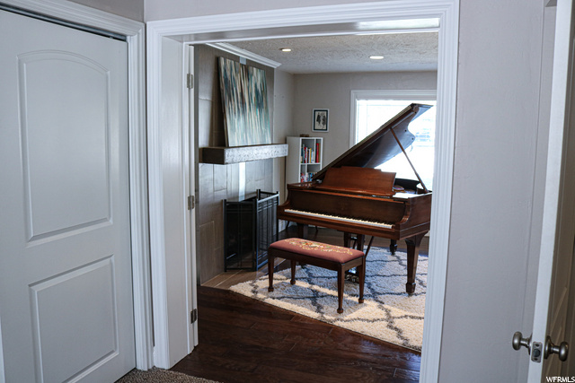 Located to the left of the piano