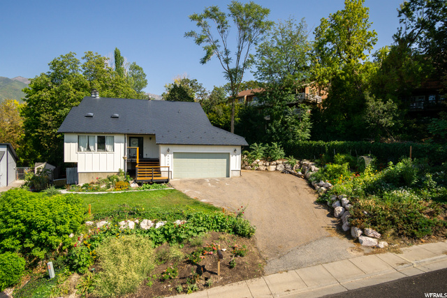 Freshly landscaped with vegetable garden on hillside to the south