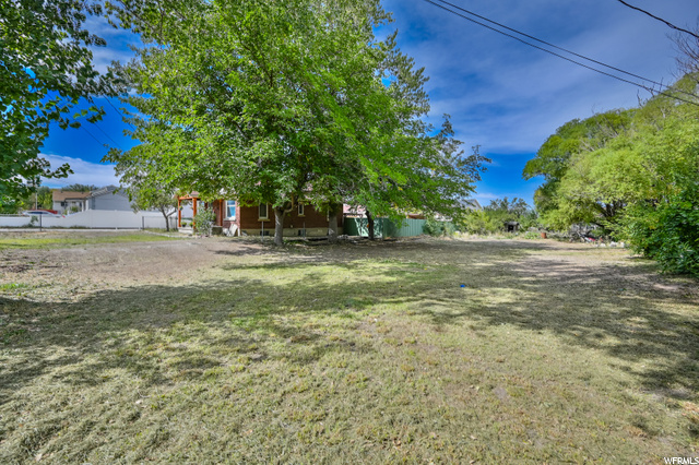"""**MULTIPLE OFFERS RECEIVED. NO MORE SHOWINGS PER SELLERS REQUEST** Huge fully fenced lot for animals and space with mature trees and wildlife. Rural property feel but not far from anything. May have the potential to be subdivided or used as horse property. Sale includes parcel numbers: 14-28-251-039-0000, 14-28-251-052-0000 and 14-28-251-055-0000. Property has a bungalow and out buildings on it. Property to be Sold in it's """"As-Is"""" condition."""