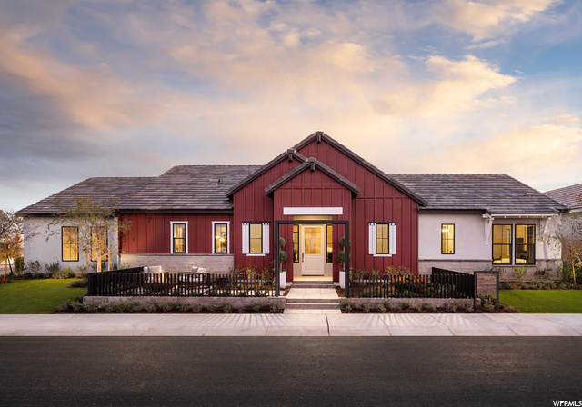 Home pictured is a different floor plan, but Larsen Farmhouse exterior architecture and colors will be similar to photo